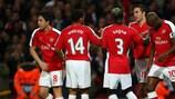 Robin van Persie is congratulated after scoring Arsenal's third