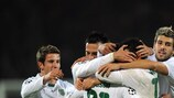 Liedson is congratulated by his Sporting team-mates after scoring against Shakhtar