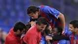 Carlitos is mobbed by his team-mates after opening the scoring