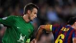 Sergei Semak (FC Rubin Kazan) y Xavier Hernandez (FC Barcelona)