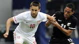 Serbia's Miloš Ninković (left) holds off Leo Bertos of New Zealand during their friendly