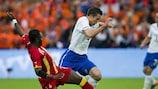 Dutch striker Robin van Persie (right) tries to evade Ghana's Sulley Muntari