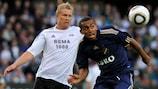 Walid Atta (right) beats Rosenborg's Stefen Iversen to possession