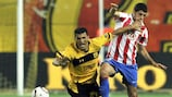 Aris defender Nikos Lazaridis goes to ground during the shock defeat of holders Atlético