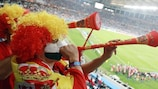 Supporters blowing vuvuzelas during the World Cup