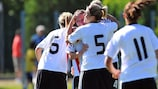 Germany's Isabella Schmid is congratulated by Luisa Wensing (No5)