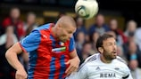 Plzeň's David Bystroň (left) heads clear under pressure from Rade Prica