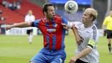 Captains collide: Plzeň's Pavel Horváth (left) challenges Mikael Dorsin