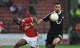 Mathieu Beda (right) holds on Standard's Aloys Nong during their 1-1 draw in Liege