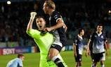 Dinamo goalkeeper Ivan Kelava celebrates with team-mate Domagoj Vida at the full time whistle