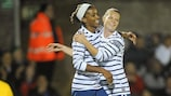 Élodie Thomis (left) congratulates fellow substitute Eugénie Le Sommer on putting France three up