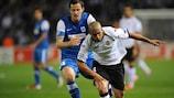 Genk's Dániel Tőzsér chases down Valencia's Sofiane Feghouli