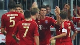 Mario Gomez (C) celebrates his second of the match just before half-time