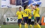 Rachel Corsie congratulates Jennifer Beattie (right) on Scotland's second goal