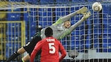 PSG goalkeeper Nicholas Douchez makes a save against Slovan