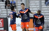 Montpellier's Olivier Giroud (C) celebrates with team-mates after scoring against Marseille