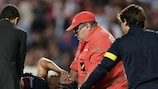 Barcelona's Carles Puyol is carried off after dislocating his elbow against Benfica