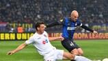 CFR's Ionuţ Rada slides in on Inter's Esteban Cambiasso