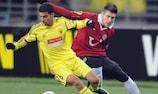 Anji's Mbark Boussoufa holds off Sergio da Silva Pinto of Hannover