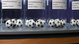 Balls lie in their pots ahead of the second qualifying round draw