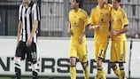 Marko Dević (No33) is congratulated after scoring one of his two goals against PAOK