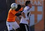 Didier Kadio contests a high ball with Nikola Ninković during a hard-fought encounter in Gyumri