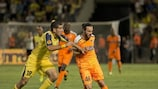APOEL's Stathis Aloneftis holds off the challenge of Eytan Tibi