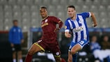 Zulte Waregem's Frédéric Duplus (L) and Nick Powell of Wigan jostle for possession