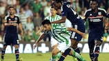 Betis's Chuli looks to evade the attentions of Lyon's Bakary Koné