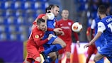 Thun's Andreas Wittwer (left) attempts to dispossess Genk's Thomas Buffel