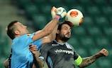 Apollon goalkeeper Isli Hidi makes an important intervention in Warsaw