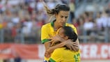 Tyresö' new signing Thaisa celebrates her recent goal for Brazil against the United States with Rosana, from the Swedish club's quarter-final opponents Neulengbach