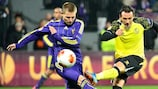 Martin Milec challenges Sevilla's Piotr Trochowski