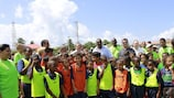 UEFA President Michel Platini and CONCACAF President Jeffrey Webb are joined by youngsters at a grassroots event in the Cayman Islands.