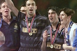 Youri Djorkaeff celebrates winning the 1997/98 UEFA Cup final with Inter