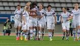 Lyon celebrate scoring at Paris