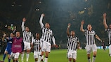 Juventus players celebrate in front of their jubilant fans