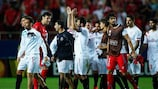 Sevilla salute their supporters at the final whistle