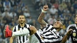 Juventus's Arturo Vidal in action against Raphaël Varane