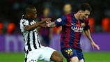 Patrice Evra tries to catch Lionel Messi in Berlin