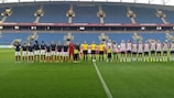 The teams line up before the game