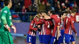 Antoine Griezmann celebrates his second goal as Fernando Muslera looks on