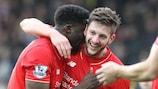 El Liverpool celebra el tano de la victoria de Lallana en Norwich