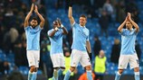Manchester City applaud the home support after sealing progress