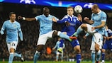 Mykola Morozyuk is surrounded by City players as he contests a high ball
