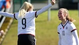 Germany's Franziska Gieseke (No10) celebrates with Nina Ehegötz against Poland