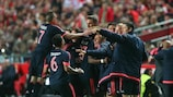 Bayern players celebrate their second goal at Benfica