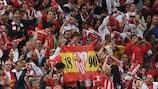 Sevilla supporters celebrate their third successive UEFA Europa League final success