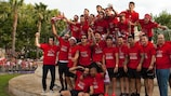 Sevilla players pose by the fountain at Plaza Puerta Jérez