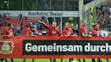 Leverkusen players celebrate qualifying for the group stage